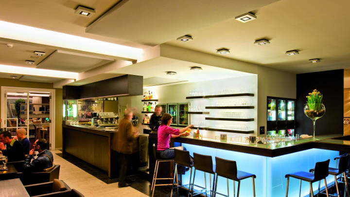 Reception at Ariane Hotel, Belgium lit by Philips hospitality lighting