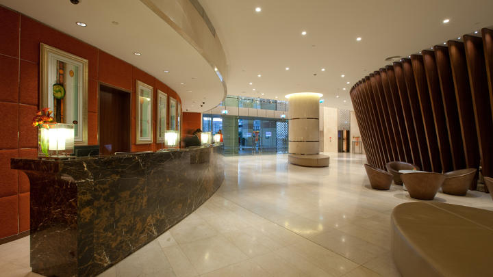 The reception area of Dubai Hotels lit by Philips Lighting