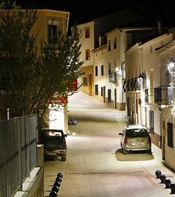 A narrow street at the town of Salobre well lit with Philips street lighting