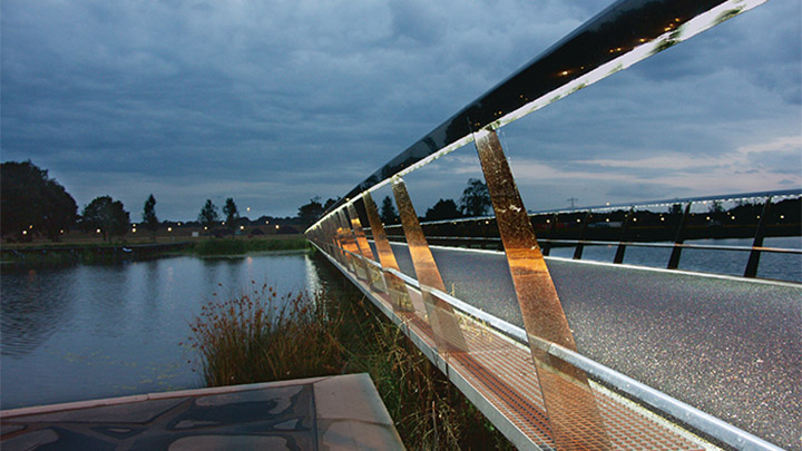 Bridge at High Tech Campus start illuminating as the sun goes down