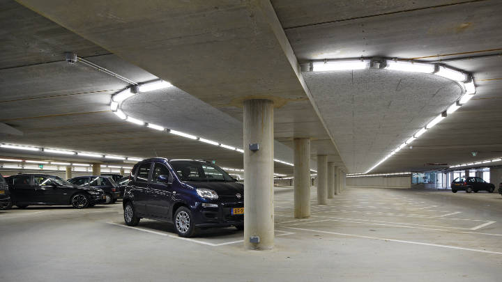 Parking garage and its information desk lit by Philips lighting